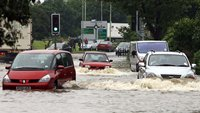 Cars driving in flood water
