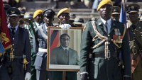 Military men in Zimbabwe holding a portrait of Robert Mugabe