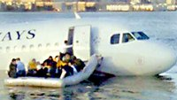 The crashed plane floats on the Hudson river
