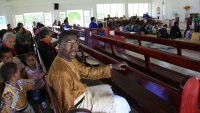 Kwame Kwei-Armah in church in Tonga