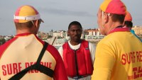 Kwame Kwei-Armah on Bondi Beach with Life Guards