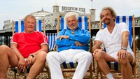 Three men sitting in deckchairs
