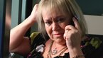 Mimi on the phone looking upset