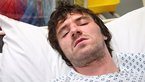 Shane in a hospital bed