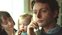 Michael Sheen as Tony Blair talking on the phone