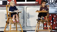 Two children in high chairs