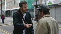 Roy gives money to a beggar