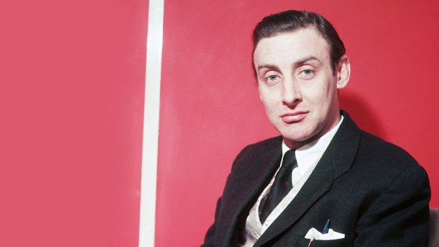 Spike Milligan next to wall