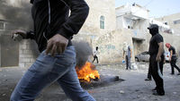 Palestinians during clashes with Israeli police in the Abu Tor neighbourhood of east Jerusalem (Reuters)
