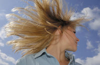 Woman shaking hair outside