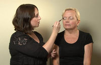 Make-up artist Lauren Dunn shows an older woman an easy, flattering make-up look