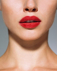 A woman wearing red lipstick
