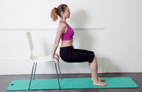 A pilates instructor teaches exercises for the arms
