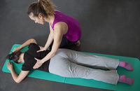 A Pilates instructor teaches exercises to strengthen the back