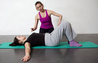Pilates instructor Tatiana shows Lelia how to do the hip roll