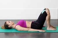Pilates instructor Tatiana demonstrates how to connect your abdominal muscles in a lying down stance