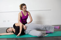 Pilates instructor Tatiana shows Lelia the abduction exercise