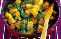Spicy potatoes and green peas