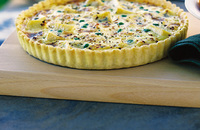 Pea, pancetta and cheese tart