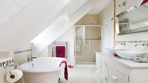 The shower fits snugly at one end of the loft