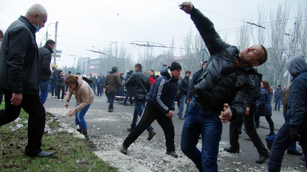 Pro-Russia protesters storm a police building in eastern Ukraine (Getty Images)
