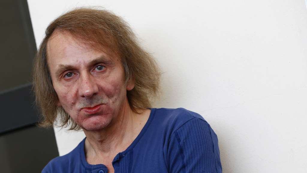 It is an unnerving coincidence: as Michel Houellebecq's controversial new novel was published on Wednesday, terrorists raided the offices of Charlie Habdo and murdered 12 people (Reuters)