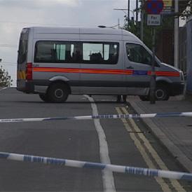 Police at the scene of Mark Duggan's shooting.