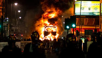 A burning bus in Tottenham North London during recent riots. An invited studio audience from cities affected by rioting joined a panel to discuss the causes and solutions.