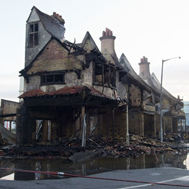Graham Reeves, 52, spoke of his devastation as he surveyed the smouldering remains of the House of Reeves in Croydon.