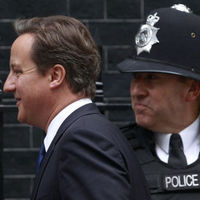 Cameron vow as police row simmers (Reuters)