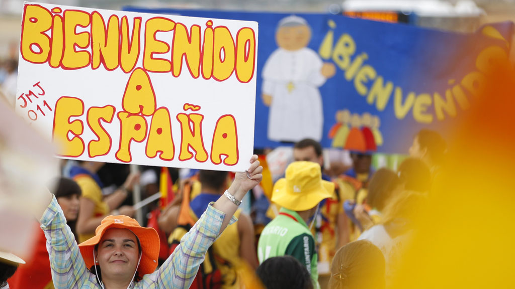 Supporters gather to welcome the Pope to Spain (Reuters)
