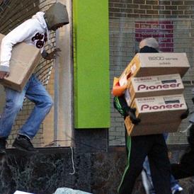 Birmingham riots: youths take hi-fi equipment during looting. (Reuters)