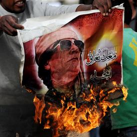 Gaddafi poster burns - Getty
