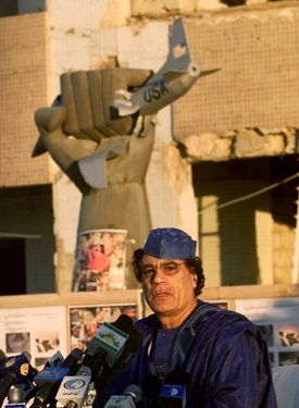 Colonel Gaddafi pictured with the iconic fist statue in 2001. (Reuters)