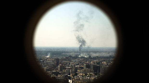 Smoke billows from the Bab al-Aziziya compound - formerly Gaddafi's stronghold - in Tripoli (Reuters)