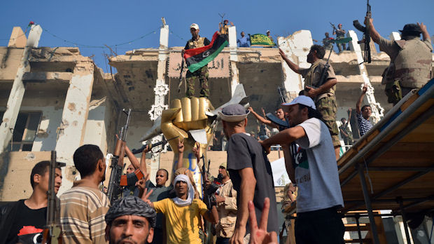 Libya rebels in Gaddafi's Bab al-Aziziya compound in Tripoli (Getty)