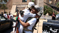 Photos from the front line as jubilant rebels succeed in capturing Gaddafi's compound from loyalist forces.