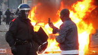Rioter using a phone - Reuters