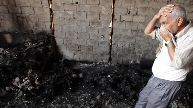 Libya: charred bodies near Khamis military base. (Getty)