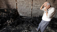 Libya: charred bodies near Khamis military base. (Getty)