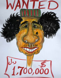 A wanted poster for Gaddafi in Libya (Getty)