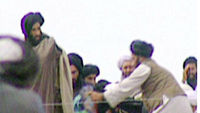 Reclusive Taliban leader Mullah Mohammed Omar seen at a Kandahar rally.