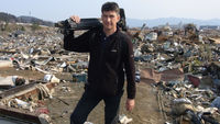 Alex Thomson in the tsunami-hit town of Minamisanriku in March 2011.