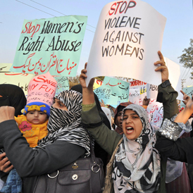 Supporters of Tehrik-e-Minhaj ul Quran, an Islamic Organisation protest against 'honour killings' of women in Lahore on November 21, 2008 (Getty)