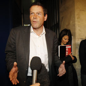 FSA boss Hector Sants leaving meeting with Occupy London (Reuters)