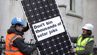 protest against cuts to solar panel subsidies (Getty)