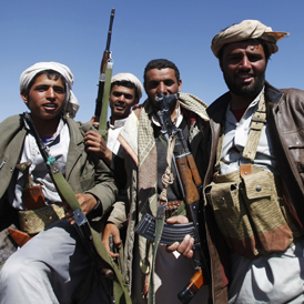 Tribesmen backing anti-government protesters escort protesters outside the central Yemeni city of Dhamar, during a protest march from the southern city of Taiz to the capital Sanaa (Reuters)