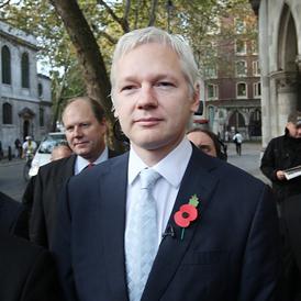 Julian Assange outside the high court in London (Getty)