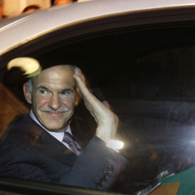 Outgoing Greek prime minister George Papandreou who will meet with the government to decide who will replace him (Reuters)