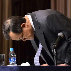 Olympus president Shuichi Takayama bows his head at a press conference in Tokyo on November 8, 2011. Olympus acknowledged wrongdoing for the first time (Getty)